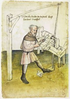 """He's using a foot powered pedal connected by rope that is wrapped around a shaft and goes up to a/ limb spring above his head. Its called a """"Pole lathe"""" to make round things of wood as they spin and get cut by the blade."""