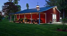 Red pole barn with porch and lighting. Would be great for get together each month. Love the covered porch. I can see it with rocking chairs!!!