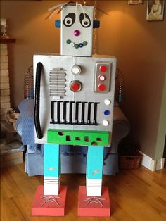 Robot made from cardboard boxes, odds & ends, slinky arms