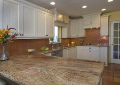 tropical kitchen by Degeorge Ceilings Flooring and Custom Cabinetry