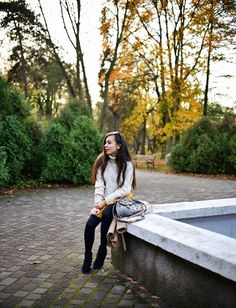 fall outfit with yellow skirt and floral bag