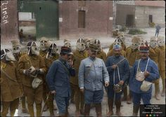 Senegalese French troops getting acquainted with their new gas masks in Proyart, Somme, June 1916.