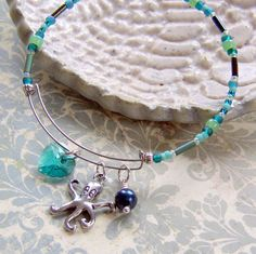 """I love the charm-adorned """"Alex & Ani"""" style adjustable wire bracelets that have been gaining popularity,..."""