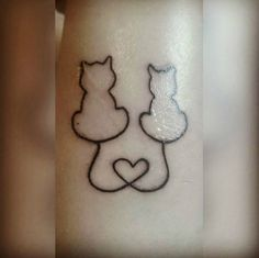 Two cats heart tattoo
