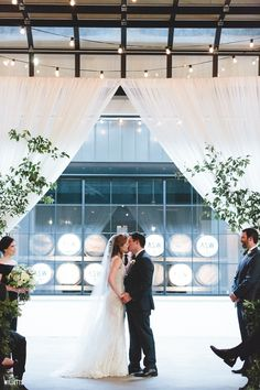 Wedding Ceremony - First Kiss | The Stave Room at American Spirit Works | Stella Harper Events | Bloomin' Bouquets | Willett Photography