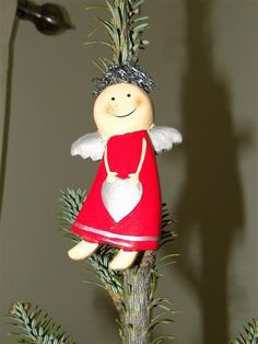 Smiling Angel Ornament Crafted in Indonesia