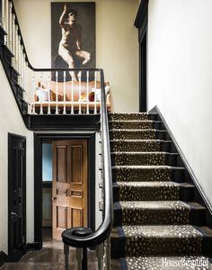 "An homage to Canada's fur-trading history, Antilocarpa carpet from Stark creates a dramatic stair runner. ""It's a great pattern, contemporary but still classic,"" says Kedigian. Trim painted in glossy Benjamin Moore Black plays up the home's architectural details. Reproductions of artworks by Géricault are featured throughout."