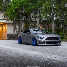 Titanium wrapped Ford Mustang - like the grill and splitter combo...but at that point I'll need an upgraded intercooler...