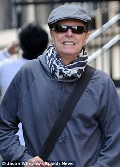 Bowie wore a tatty, grey hooded top and wraparound sunglasses