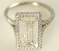 This my friend... Is a dream come true! Too bad it's $8000!!! 1carat FLAWLESS emerald cut center, 1carat halo and band diamonds.