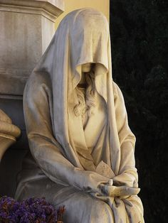 "A pleurant (French) or ""weeper"" (in English) statue that was meant to mourn eternally at grave of a loved one. Verano Monumental Cemetery, Rome, Italy."