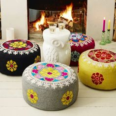 Add a splash of colour to your den with these vibrant hand embroidered felted wool pouffes.