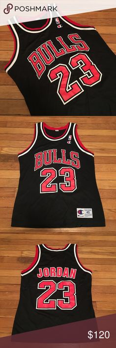 VINTAGE CHAMPION MICHAEL JORDAN BULLS JERSEY BLACK size: 40 (Medium), RARE vintage Champion Chicago Bulls Michael Jordan jersey.  9.5-10/10 condition, no tears stains or cracking.  Serious inquiries no lowballing.  Tags: champion, vintage, retro, michael jordan, mj, chicago bulls, nba, swingman, home, away, air jordan, nike, nike air, og, 90s, supreme, adidas, yeezy, boost, yeezys, reebok Champion Shirts Tank Tops