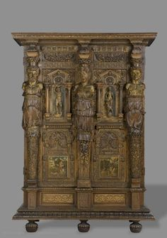 The decorations on this highly architectural piece of furniture include bas-reliefs, scupture in the round, and painted panels. It has often been compared to the work of the architect and ornamentalist Hugues Sambin (circa 1520-1601).