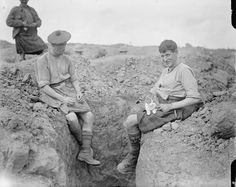 "Two men of the 9th Battalion, Gordon Highlanders (15th Division) with their pet cat. ""Martinpuich,"" August 25th, 1916. [IWM] These Are the Brave and Fluffy Cats Who Served in World War I"