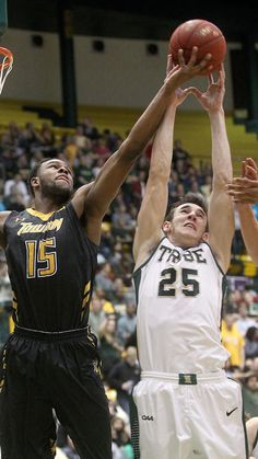 William & Mary's Terry Tarpey goes up for a rebound against Towson's Timajh Parker-Rivera during the first half Wednesday at W&M. (Photo by Rob Ostermaier / Daily Press)