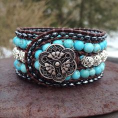 Gorgeous cuff-style wrap bracelet made with hematite and turquoise howlite stone and silver-plated metal beads sewn around brown leather cording with durable thread.
