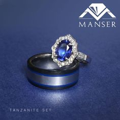 Gents ring is a titanium ring with black Teflon sides and blue resin inlay. Ladies ring: white gold and tanzanite ring with shaped diamond halo. Tanzanite Engagement Ring, Tanzanite Ring, Engagement Ring Settings, Engagement Rings, His And Hers Rings, Gents Ring, Titanium Rings, Halo Diamond, Resin