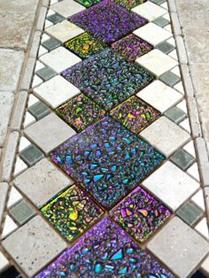 Dichroic Tiles - knowing how much Dichroic glass costs I should imagine each time is worth a fortune - perhaps they are tiles to have inside!