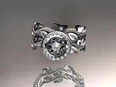 platinum diamond leaf and vine wedding ring,engagement ring,engagement set. $2,450.00, via Etsy.