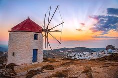 Stunning sunset from the top of the mountain with the wonderful windmills , at Amorgos island ( Αμοργός ) . Very impressive Chora village , perfect for a walk into the traditional Cycladic alleys .