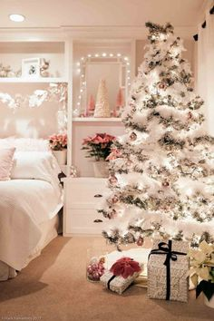 This pink Christmas decor is a winter wonderland. Pink poinsettias, bottle brush trees, and vintage pink ornaments are all the decor used in this holiday bedroom. It is festive, pretty, and feminine and perfect for the long winter nights. Christmas Feeling, Christmas Night, Christmas Home, Christmas Tree For Bedroom, Diy Christmas Room Decor, Girly Christmas Tree, Winter Bedroom Decor, Vintage Pink Christmas, Christmas Mantles