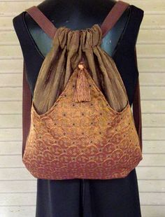 Brown Backpack With Copper Geometric Pattern by piperscrossing