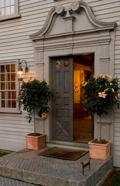 Love the planters and trees flanking the door. Twinkle lights at Christmas or year round?