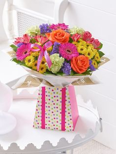 Surprise and delight them with this colourful gift box full of flowers!