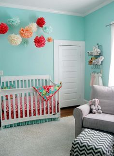 Coral and Aqua Crib Bedding from @StudioSlumber - we love this color combo in a bright, airy baby girl nursery!