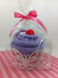Fuzzy socks into cupcakes. Cute idea! I love anything fuzzy...socks, blankets, we are one.