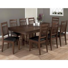 Lewis Oak 9 Pc Rectangle Table and Slat Chair Set. Something like this.