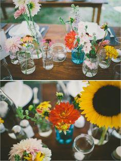 mismatched jars used as vases // super cute backyard wedding