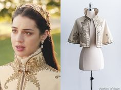 "In the episode 2x07 (""The Prince of the Blood"") Queen Mary wears a vintage Gold Embroidered Turkish Capelet similar to this one from the Gossamer Vintage (pictured above).Worn with an Alexander McQueen blouse, Rosantica headband, Magwood Boutique earrings."