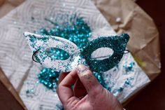 Your Own: Mardi Gras Mask DIY Mardi Gras Mask. You can get the kids to color half, and the other half is glitterDIY Mardi Gras Mask. You can get the kids to color half, and the other half is glitter Sweet 16 Masquerade, Masquerade Theme, Masquerade Ball, Masquerade Centerpieces, Quinceanera Centerpieces, Candle Centerpieces, Wedding Centerpieces, Mardi Gras Decorations, Mardi Gras Party