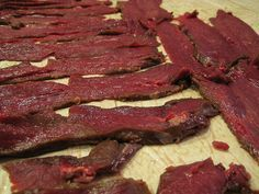 Turn your spare deer meat into this easy Sweet and Spicy Venison Jerky Recipe. After you have scored your prize buck in the woods this year, you are gonna want to turn some of that venison into my fast and easy Sweet and Spicy Venison Jerky Recipe. Sweet And Spicy Venison Jerky Recipe, Deer Jerky Recipe, Jerky Recipes, Venison Recipes, Sausage Recipes, Ground Deer Meat Jerky Recipe, Rabbit Jerky Recipe, Cooking Venison, Smoker Recipes