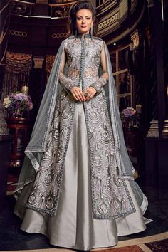 Outstanding grey designer lehenga style suit online which is crafted from net fabric with exclusive embroidery and stone work. This stunning designer lehenga style suit comes with silk bottom and net dupatta. Silk Anarkali Suits, Lehenga Suit, Lehenga Style, Silk Lehenga, Anarkali Dress, Silk Dupatta, Eid Dresses, Pakistani Dresses, Indian Dresses