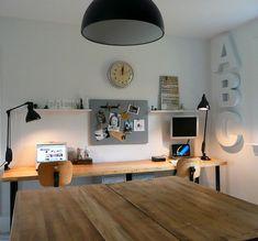 shared desk, wood, wall shelves, mounted monitor