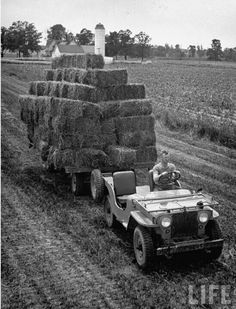 Willys CJ2A pulling a trailer load of hay.