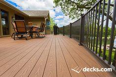 Custom Radius Deck built by Creative Concepts & Design, LLC of Kansas City. Decking products include. Tufboard PVC Decking Westbury Handrail Fortress deck lighting