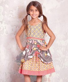 With a darling mix of prints and elegant layered pick-up skirt, this dress is ready for a walk on the smile side. Soft cotton and buttons in back keep cuties comfy with delightful ease.