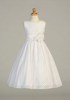 An exquisite style that can be worn event after event. This style features a polka dot burnout design with taffeta waistband and flower accent. Dress is perfect for any Flower Girl or First Holy Communion. Dress offered only in White. This dress is seasonal, so if you are thinking of this dress, we advise that you may want to plan accordingly for the upcoming event. Take a look at the large pictures of this dress so that you can appreciate the fabric and exquisite workmanship on this dress…