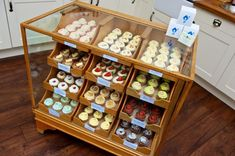 Our cake cabinet is a vintage haberdashery. We are terribly fond of it and take great care to keep it looking shiny and smudge free!