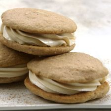 Apple Spice Whoopie Pies - As American as apple pie, and as New England as a whoopie pie, these sweet saucers of spice abound with the flavors of Fall. Two generous cakes sandwich a rich cinnamon-cider buttercream filling. It is one of the most decadent desserts you can hold in one hand.