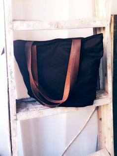 Totebag linen black colour with leather strap size 40 cm x 35 cm x 10 cm price IDR 180.000 cp: +62 81227800577