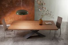 """A modern wooden dining table with uneven edges and an elegant appearance seems to be almost imaginary. Riflessi but have done it with their """"Living Table""""."""
