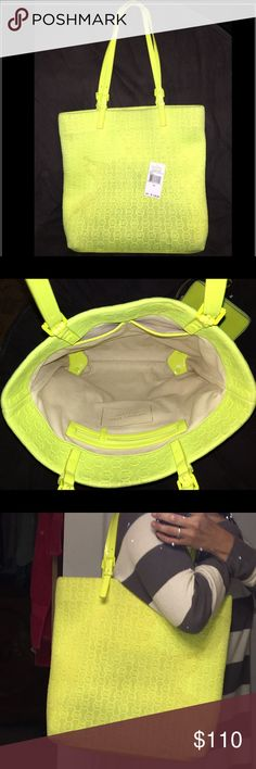 Michael kors jet set neon yellow large tote Michael kors jet set neon yellow (neoprene) large tote. Authentic. I tried taking pics of the stains on the outside and on the top inside of one side of the bag. The inside of bag does not have any major or visible stains that I could see. Still have tag as shown in pic. This mk has lots of love still to share! Michael Kors Bags Totes