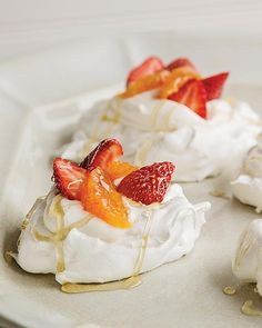 My Grandmother made a beautiful pavlova, white as snow, and filled it with whipped cream, strawberries, oranges, and topped it off with a drizzle of honey. It was divine.  #SweetPaul