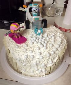 """Need: two cakes, frosted with white buttercream. 9 white chocolate kit kats and """"snowballs"""" I used white coated chocolate candy balls found at local grocery store in baking section . Girls Paw Patrol Cake, Skye Paw Patrol Cake, Paw Patrol Birthday Cake, 4th Birthday Cakes, Birthday Fun, Fourth Birthday, Birthday Parties, Birthday Ideas, Diy Cake"""