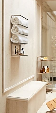Even loaded with three levels of folded towels, our Marais Teak/Stainless Towel Rack maintains its sleek form, with room for more.